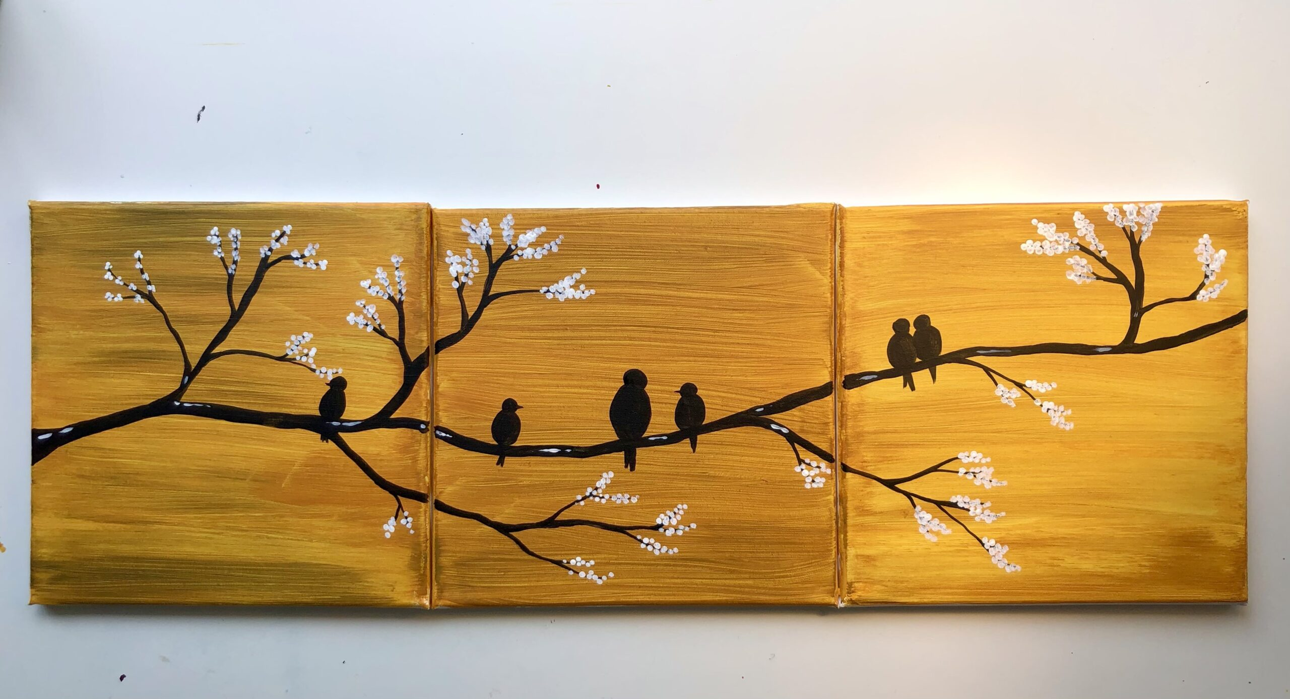 Family of birds on a branch